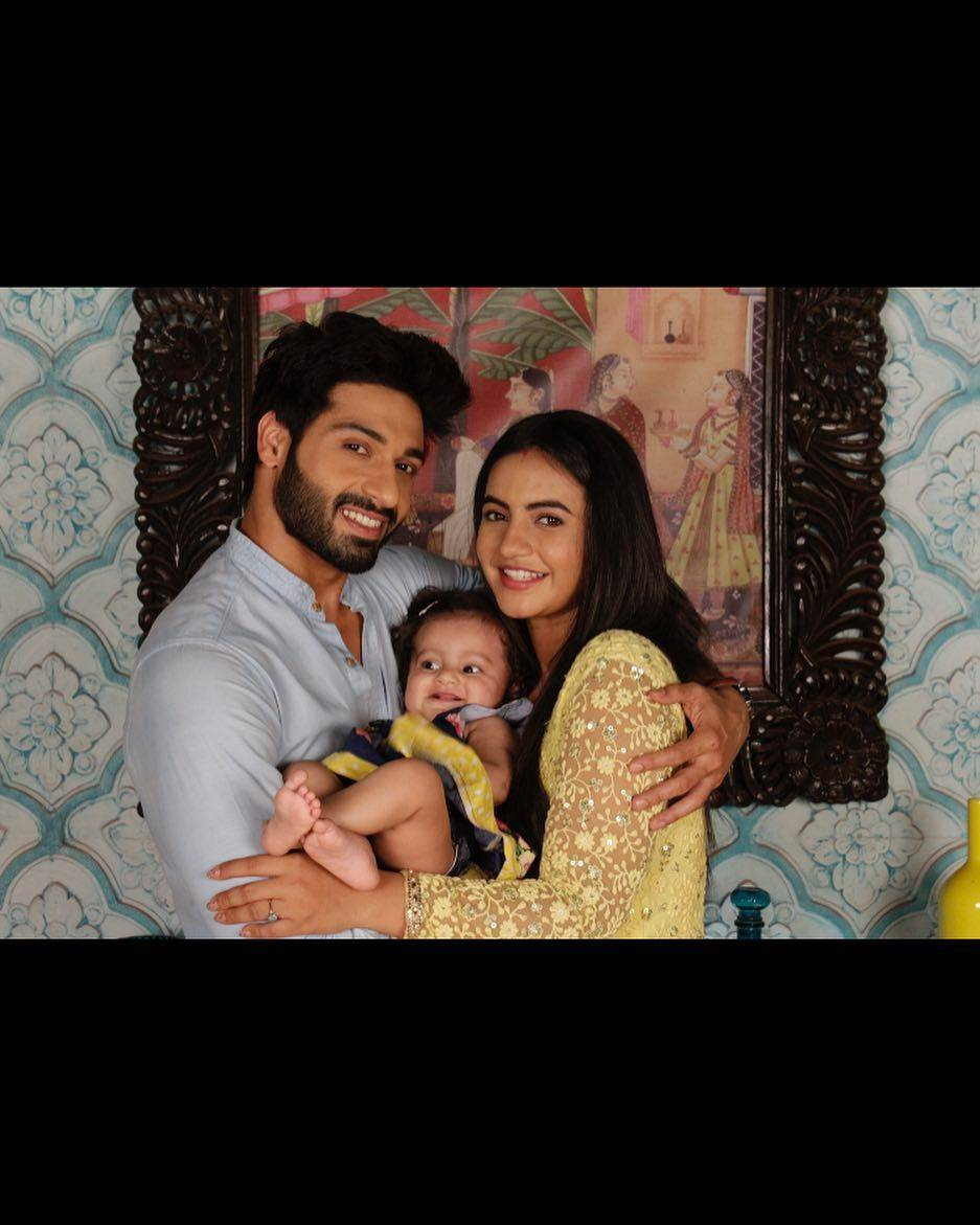 Udann:  Sooraj & Chakor pose with their little bundle of joy.